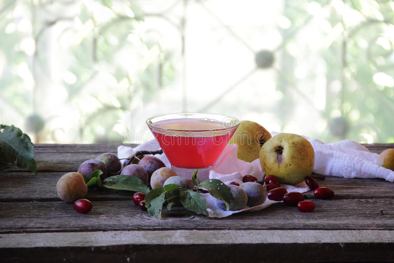 Sorbet of pears and plums in a transparent vase stock image