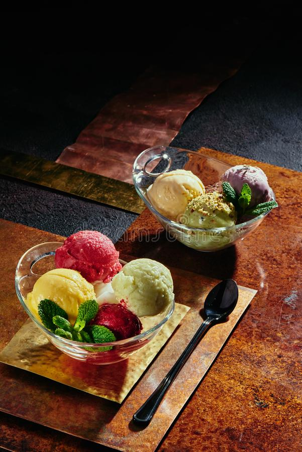 Sorbet in a transparent pial on copper plates. colorful balls of sorbet. royalty free stock images