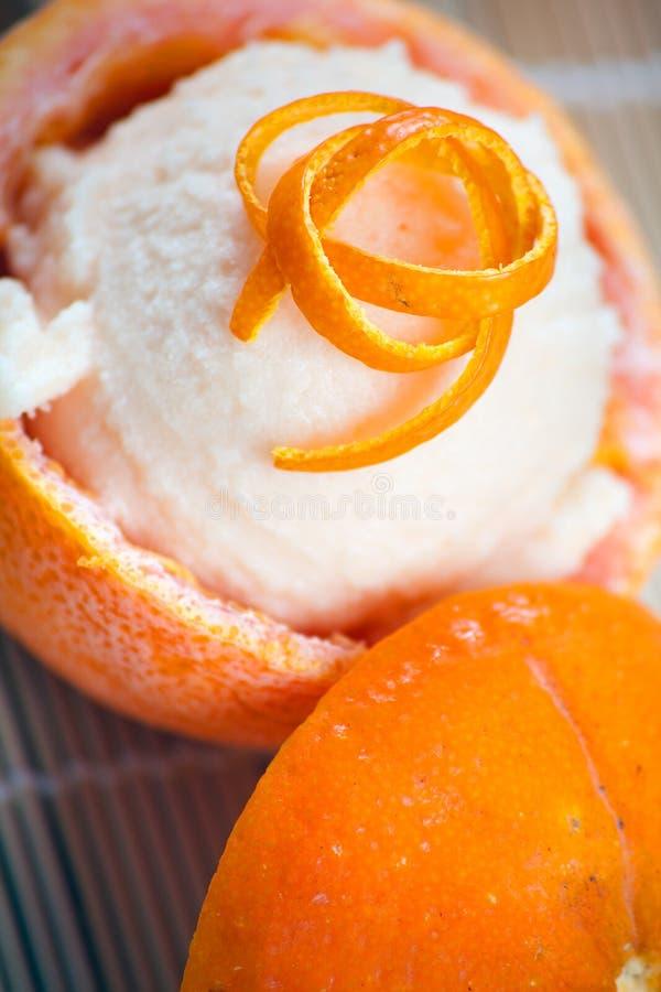 Sorbetto Arancione In Frutta Scavata Fotografia Stock
