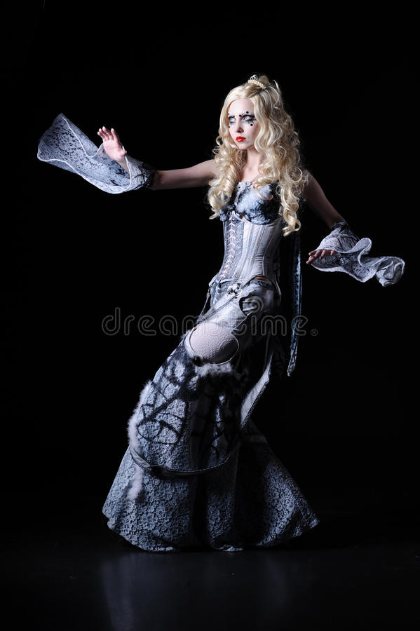 Sorcerer. With stage make-up in unusual dress, isolated on black stock photos