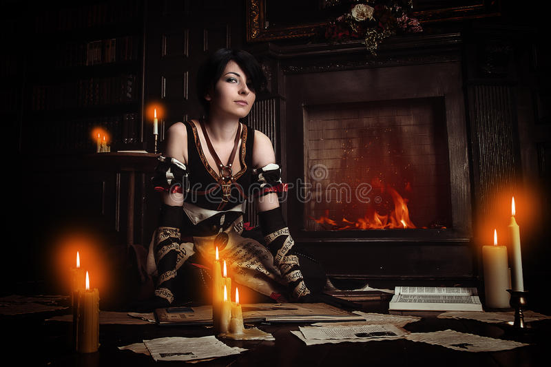 Sorceress with books. stock photo