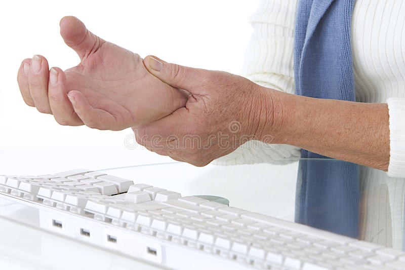 Sore wrist - occupational disease. Too much work on computer stock photo