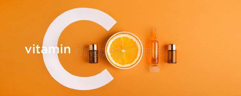 Soro e cosméticos com vitamina C Óleo essencial das citrinas bandeira imagens de stock