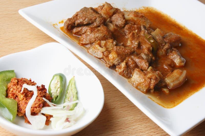 Sorpotel är en kryddig grisköttcurry från portugis royaltyfria foton