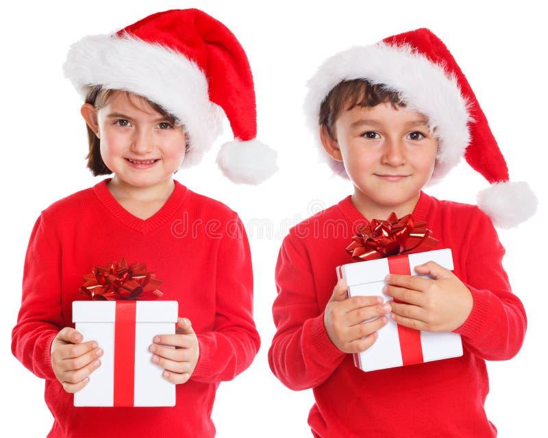 Sorpresa de Santa Claus del regalo de la Navidad de los niños de los niños actual aislada en el fondo blanco fotos de archivo