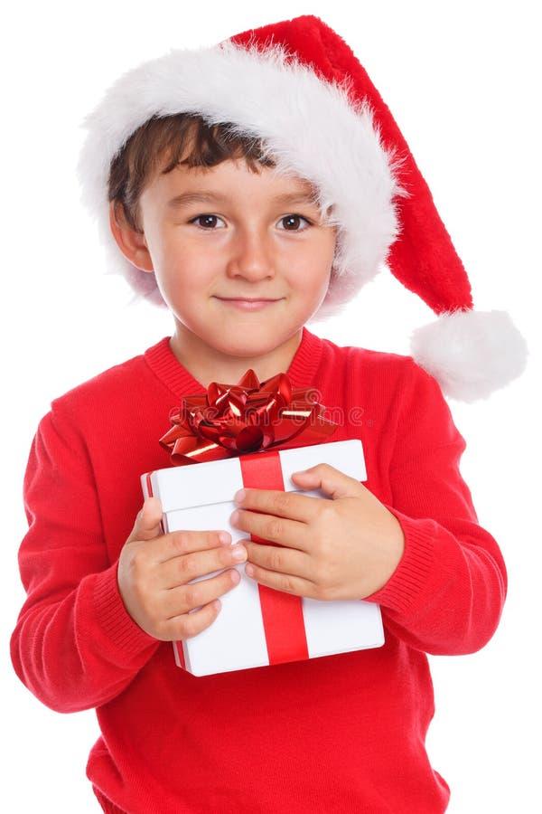 Sorpresa de Santa Claus del regalo de la Navidad del muchacho del niño del niño actual aislada en el fondo blanco foto de archivo