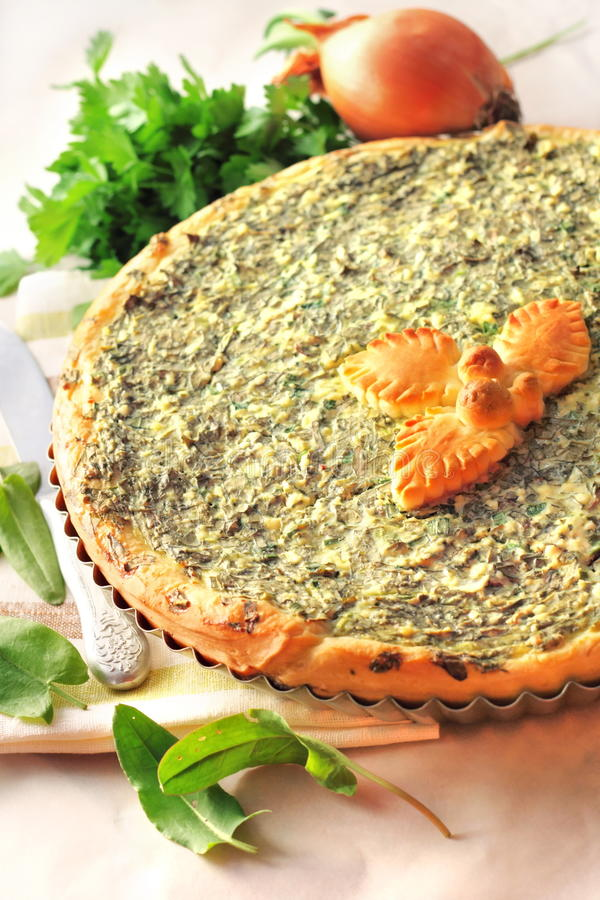 Sorrel tart with goat cheese royalty free stock photography