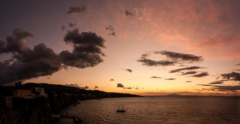 Sorrento big sky. Boats Panoramic, drifting in the evening sunset in Sorrento Bay, Campania, Italy stock photography