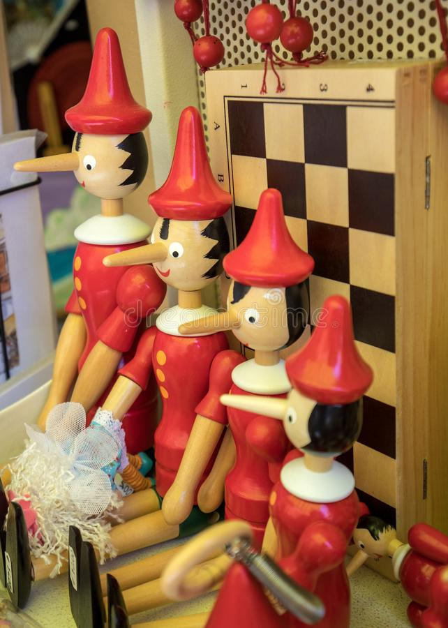 Painted wooden marionette dolls of the figure of Pinocchio. Sorrento, Italy - June 12, 2017: Painted wooden marionette dolls of the figure of Pinocchio  in a stock photos