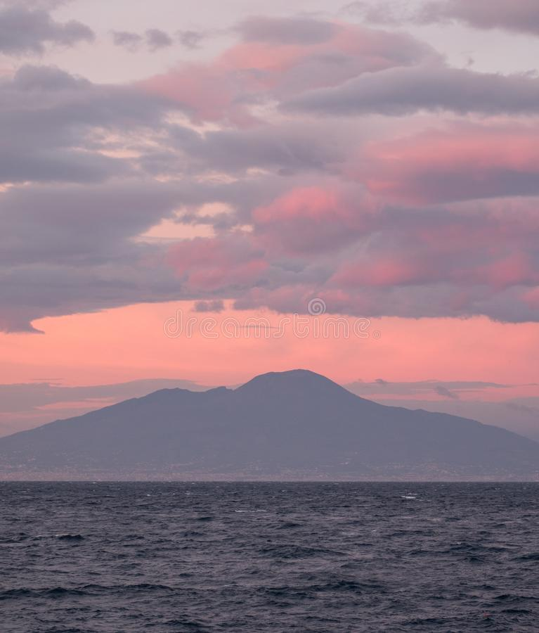 Sunset in the Bay of Naples, Italy. Mount Vesuvius can be seen on the horizon. Photographed near Sorrento . Sorrento, Italy Sunset in the Bay of Naples, Italy royalty free stock photo