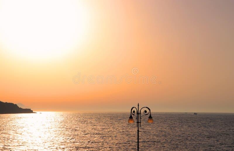 Sorrento peach color sky sunset twilight above the calm Tyrrhenian Sea. Peaceful Summer landscape. Italy, Amalfi coast stock images