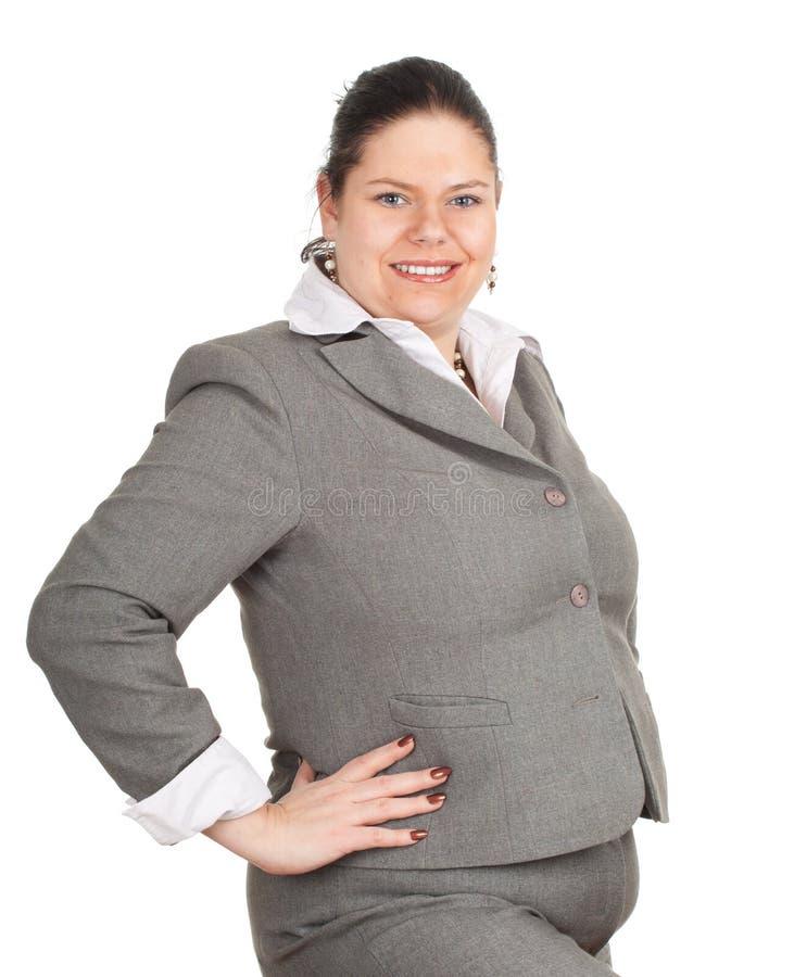 Sorridendo donna di affari di peso eccessivo e grassa fotografia stock