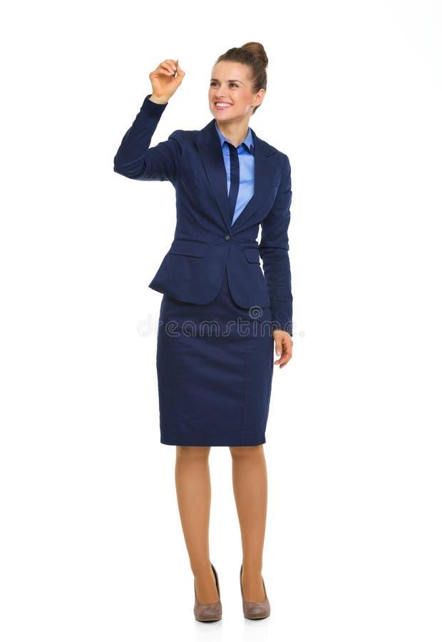 Sorridendo, scrittura elegante della donna di affari in metà di aria fotografia stock libera da diritti