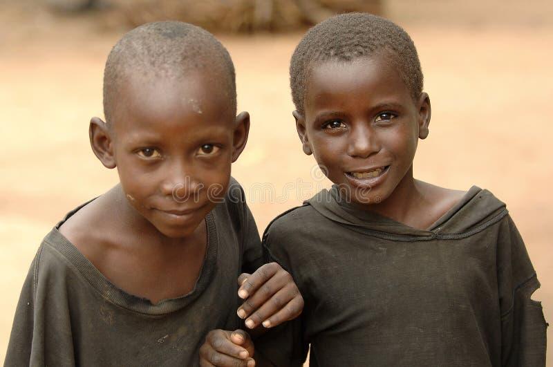 Sorridere africano difficile dei ragazzi fotografia stock