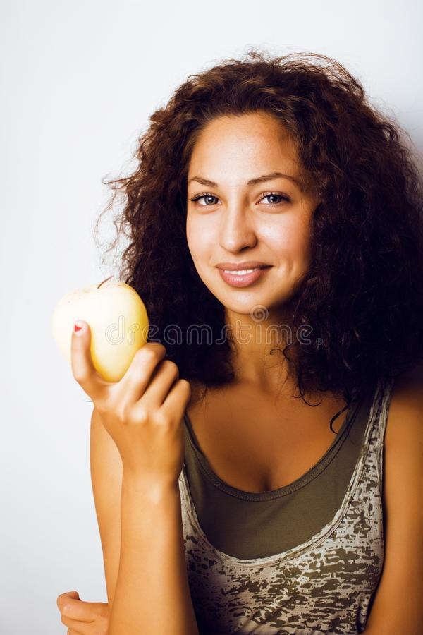 Sorridere alto vicino di tenage della ragazza della mela reale abbastanza giovane di cibo fotografie stock