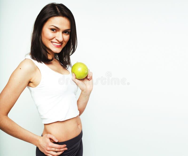 Sorridere alto vicino di tenage della ragazza della mela reale abbastanza giovane di cibo, wom fotografia stock