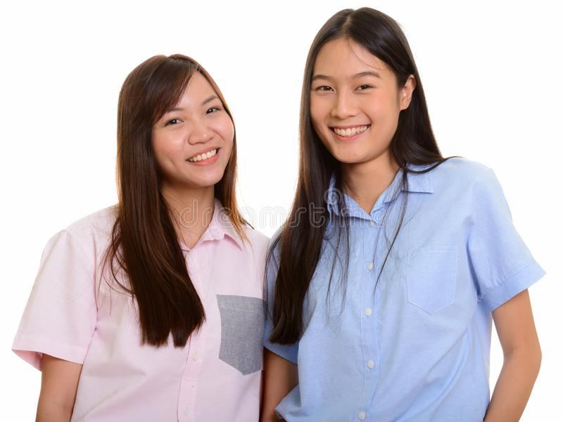Sorridere asiatico felice di due giovane adolescenti fotografie stock
