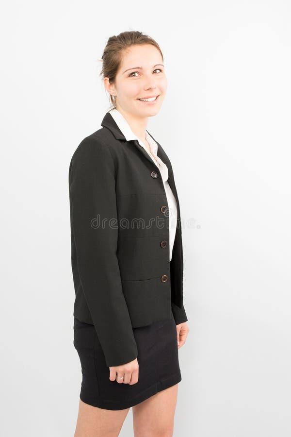 sorridere della donna di affari isolato sopra fondo bianco immagine stock libera da diritti