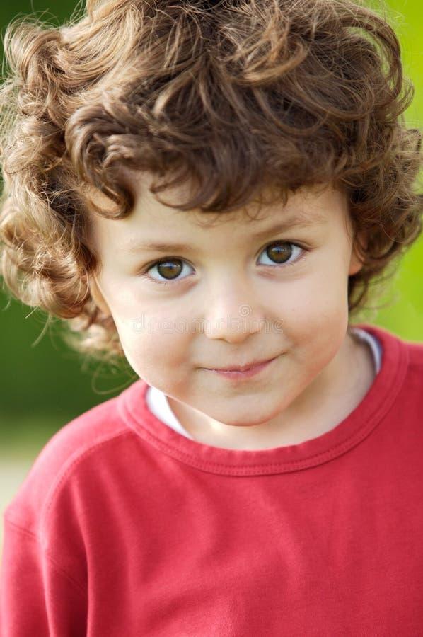 Sorridere felice adorabile del ragazzo fotografia stock