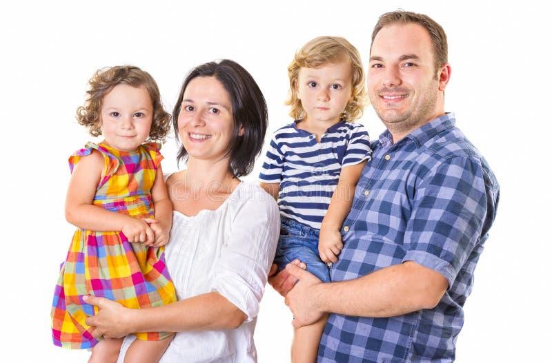 Sorridere felice di famiglia di quattro fotografie stock libere da diritti