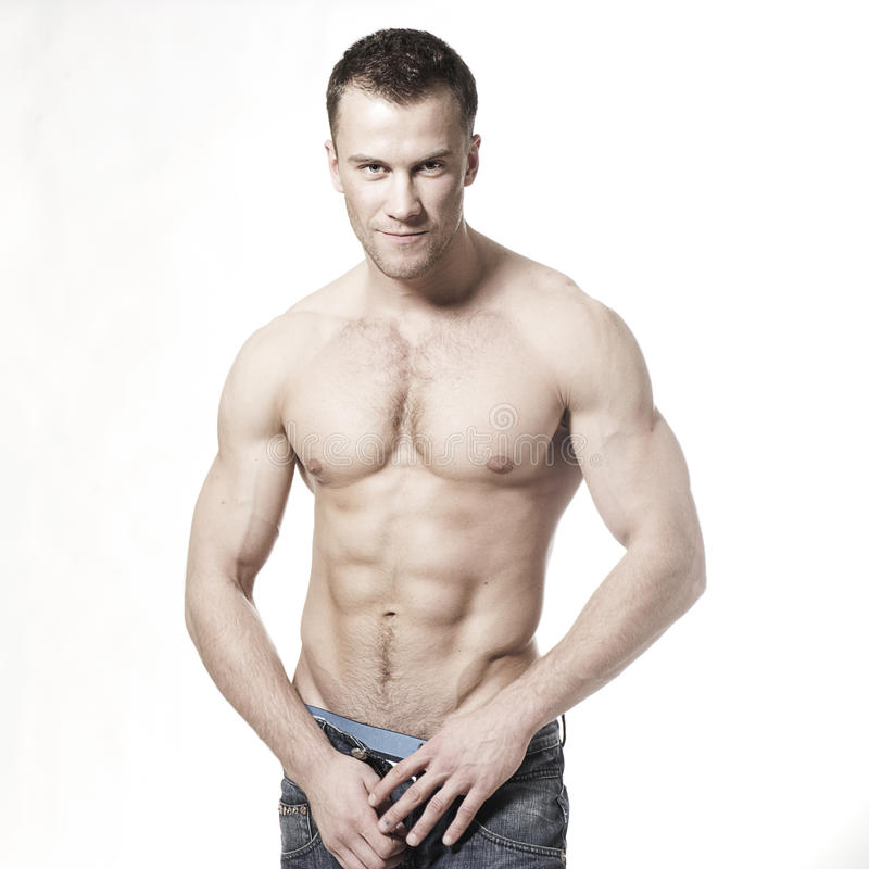 Sorridere macho muscolare sexy dell'uomo fotografia stock