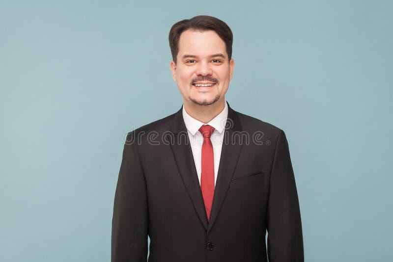 Sorridere a trentadue denti dell'uomo d'affari di felicità immagine stock