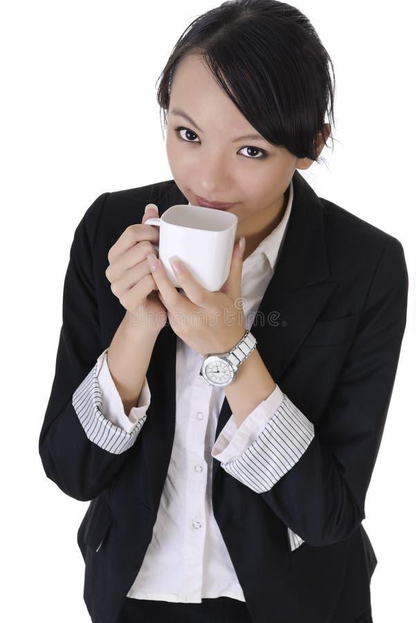 Sorrir forçadamente da mulher de negócio imagem de stock