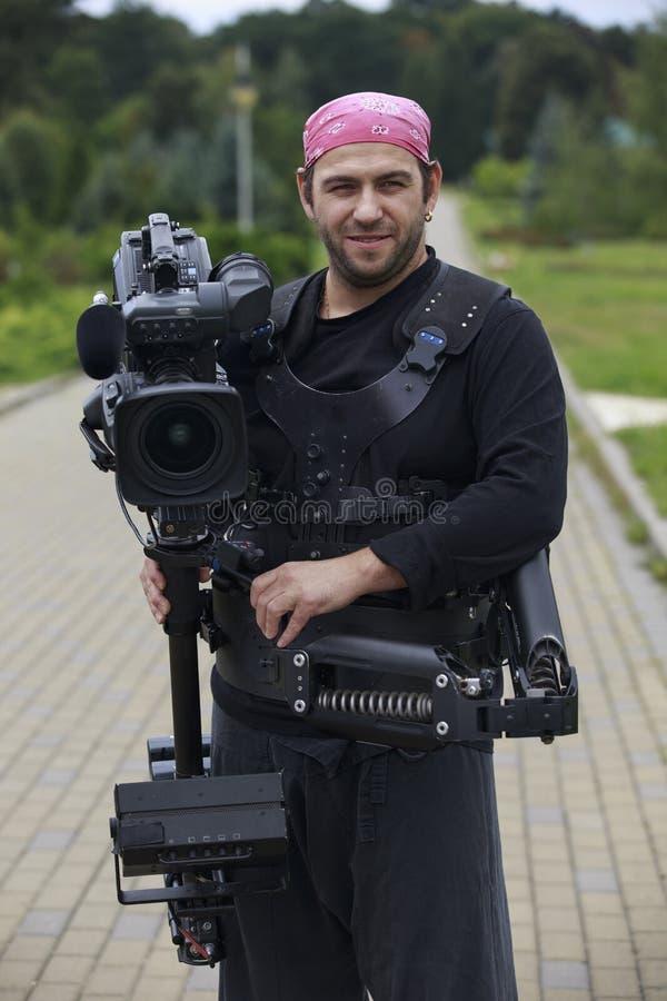 Sorrisi del cineoperatore immagini stock