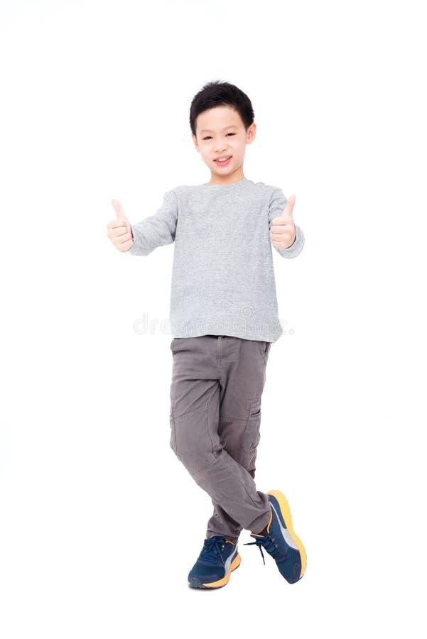 Sorrisi del ragazzo e di mostra pollice su fotografia stock