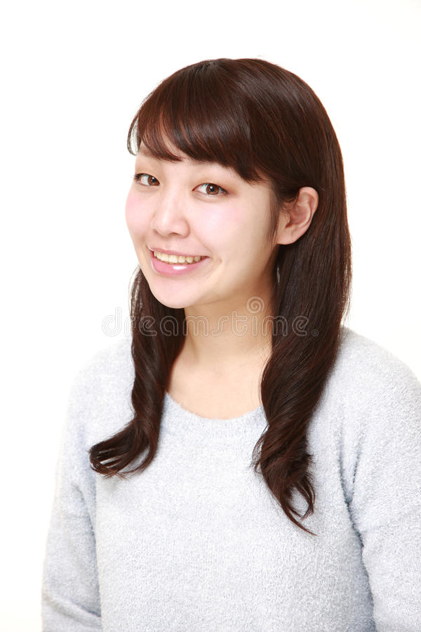 Sorrisi giapponesi della donna fotografia stock