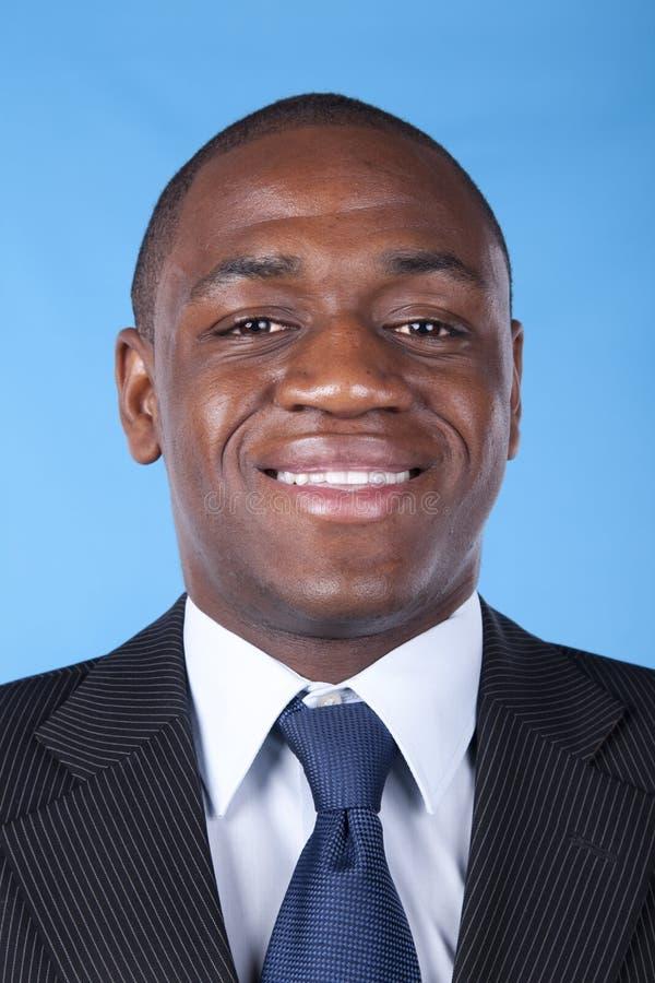 Sorriso africano do homem de negócios imagem de stock royalty free