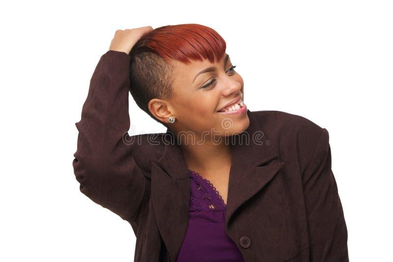 Sorriso americano africano novo bonito da mulher fotografia de stock