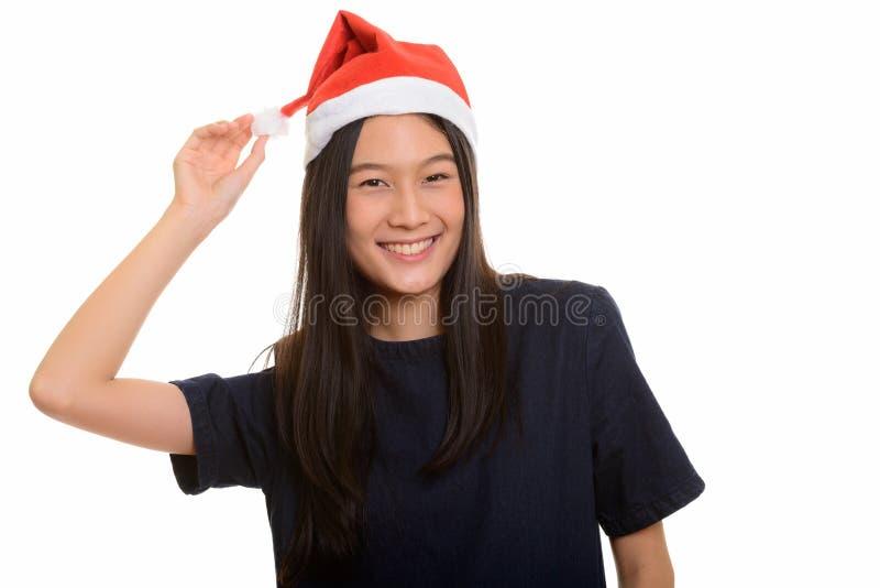 Sorriso asiático feliz novo do adolescente pronto para o Natal imagem de stock