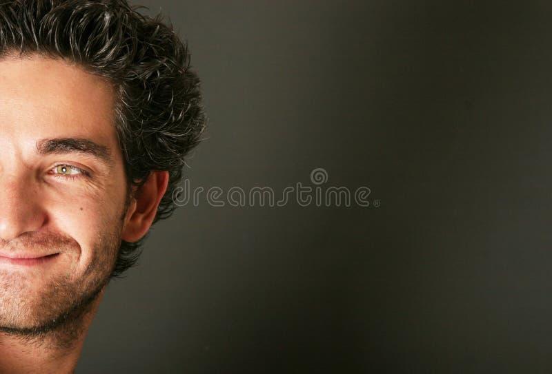 Sorriso atrativo do homem fotografia de stock royalty free
