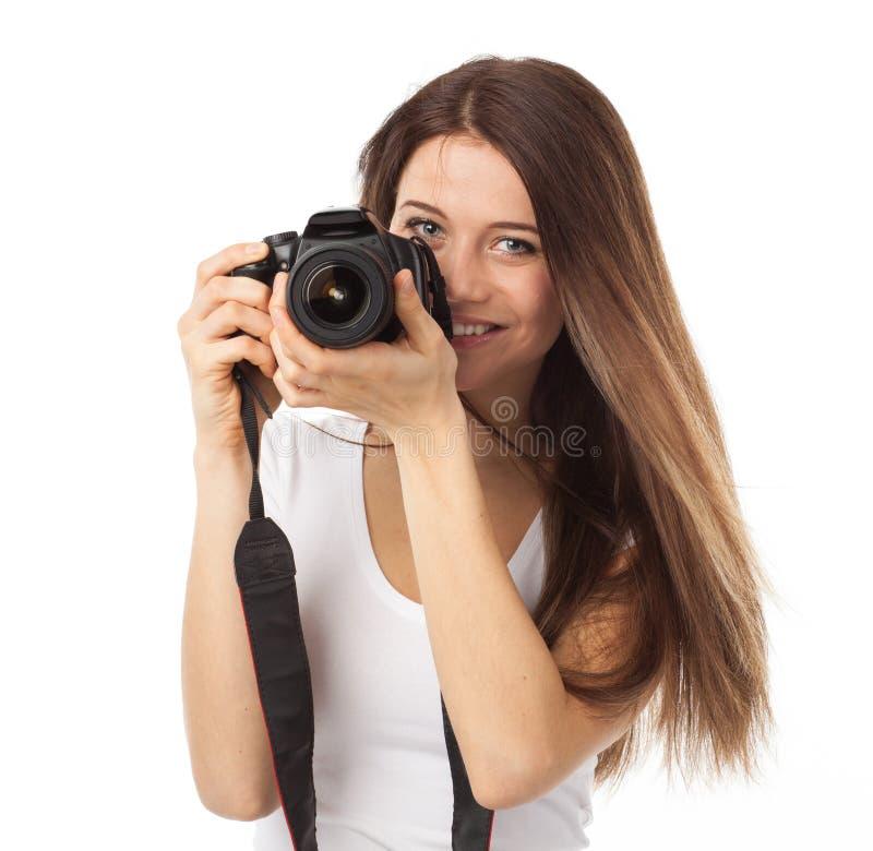 Sorriso bonito e câmara digital imagem de stock royalty free