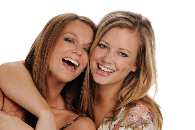 Sorriso bonito novo de duas irmãs imagens de stock