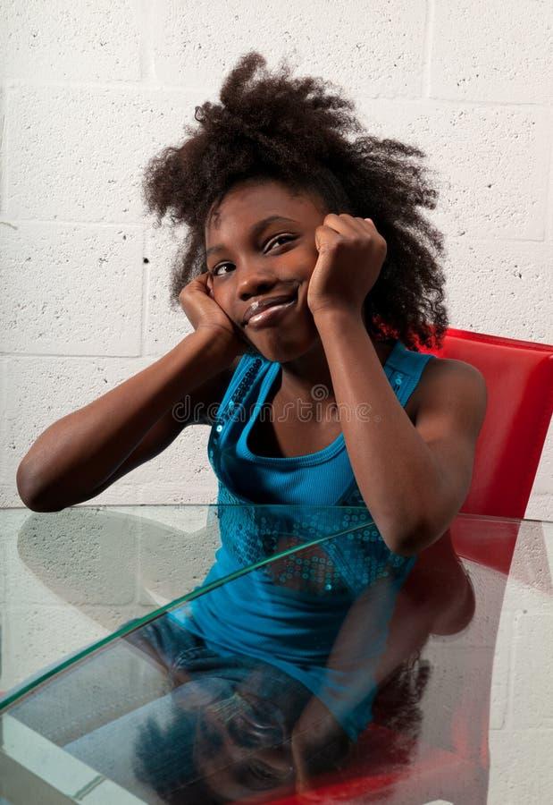 Sorriso da menina do americano africano foto de stock