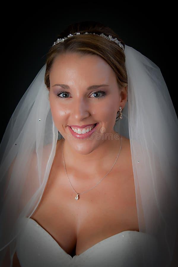 Sorriso das noivas imagem de stock