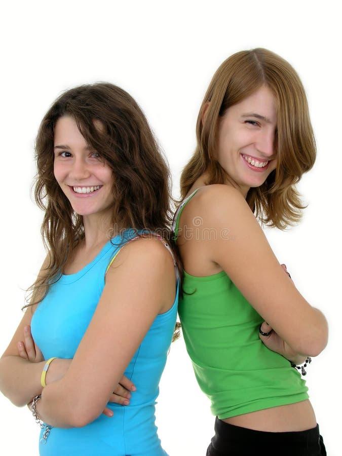 Sorriso de duas mulheres novas fotografia de stock royalty free