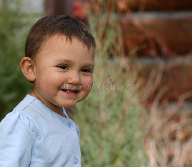 Sorriso del bambino della neonata immagini stock libere da diritti