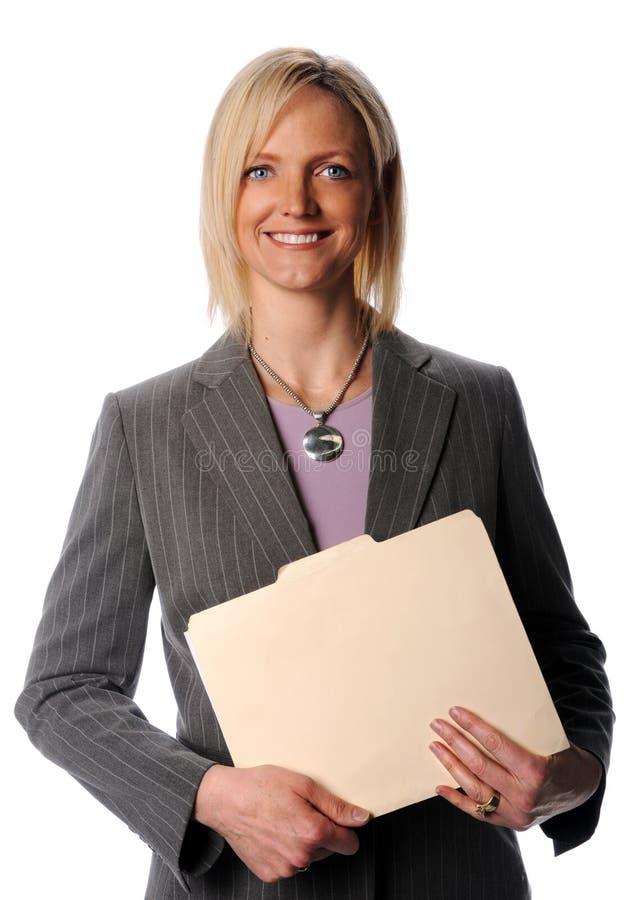 Sorriso do arquivo de terra arrendada da mulher de negócios fotografia de stock royalty free