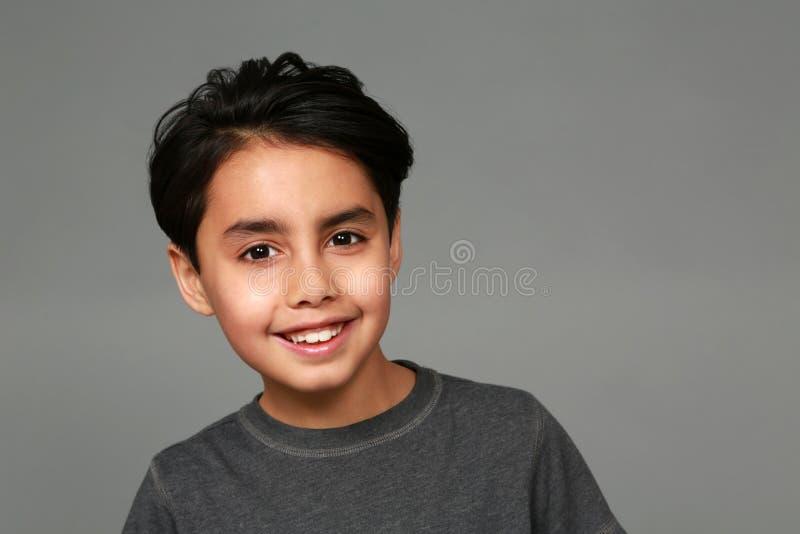 Sorriso do menino da raça misturada imagens de stock
