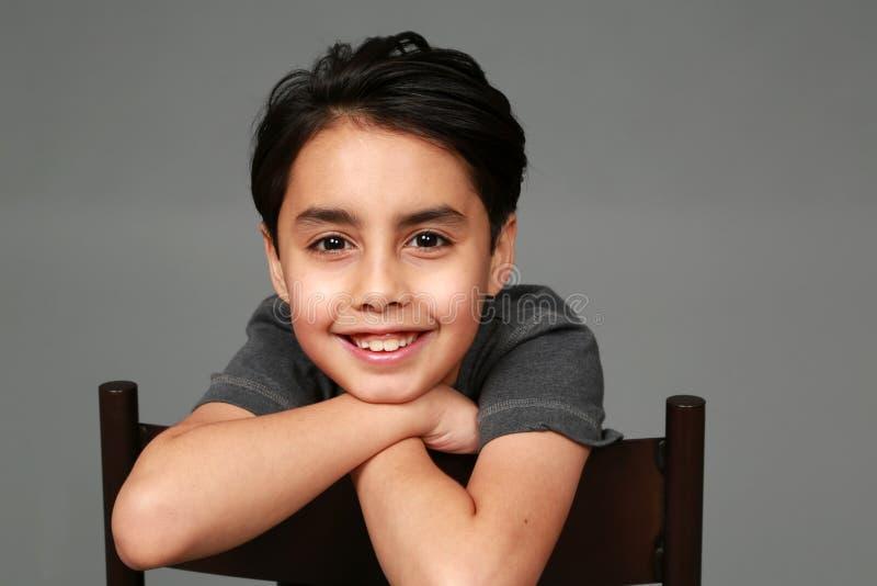 Sorriso do menino da raça misturada imagens de stock royalty free