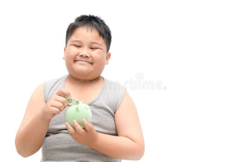 Sorriso do menino e guardar mealheiro disponível fotografia de stock royalty free