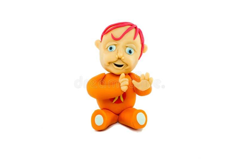 Sorriso feliz do bebê feito no plasticine imagens de stock royalty free