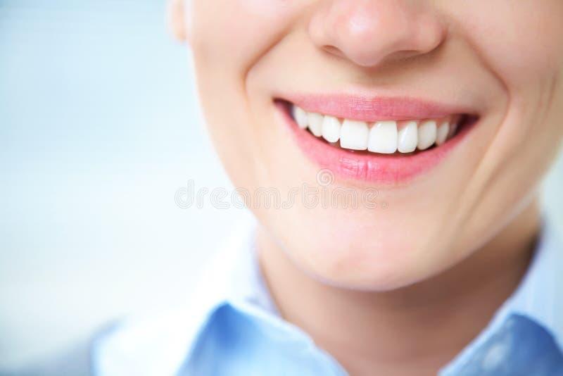Sorriso femminile fotografia stock
