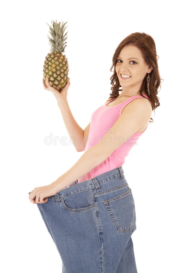 Sorriso grande do abacaxi das calças da mulher fotos de stock