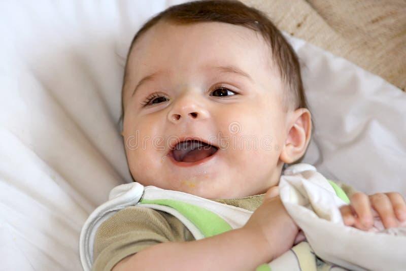 Sorriso infantil. fotografia de stock royalty free