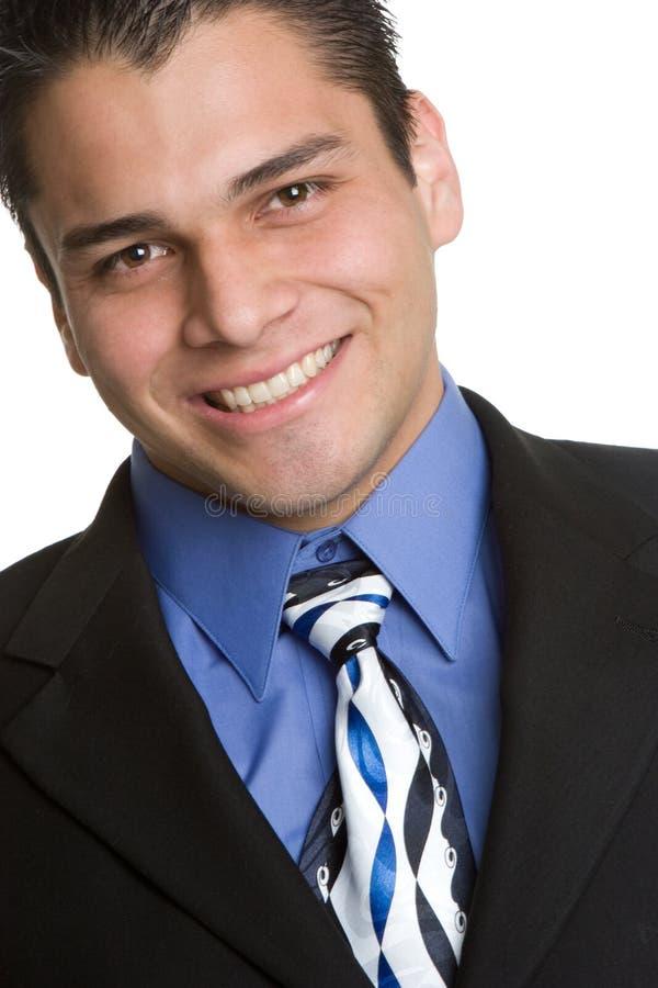 Sorriso latino-americano do homem de negócios fotografia de stock royalty free