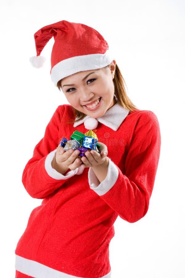 Sorriso minúsculo bonito dos presentes de Santa imagem de stock
